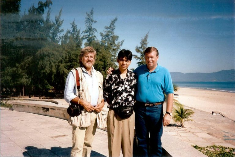 Gunner Henderson (right) with Viet Nam foreign ministry representative Chong Huang (center) and Time-Life photojournalist Dirck Halstead at China Beach near Da Nang, Viet Nam, 1994. Henderson and Halstead traveled to Saigon on assignment for LIFE magazine, and once that job was finished, they travelled the entire length of Viet Nam videotaping interviews about the last days of the Vietnam War. It was from these exhaustive interviews both in Viet Nam and elsewhere in the world, interviewing both sides of the war, including interviews with former President Gerald Ford, that Henderson wrote his award winning nonfiction book about the fall of South Vietnam and end of the war, Goodnight Saigon.
