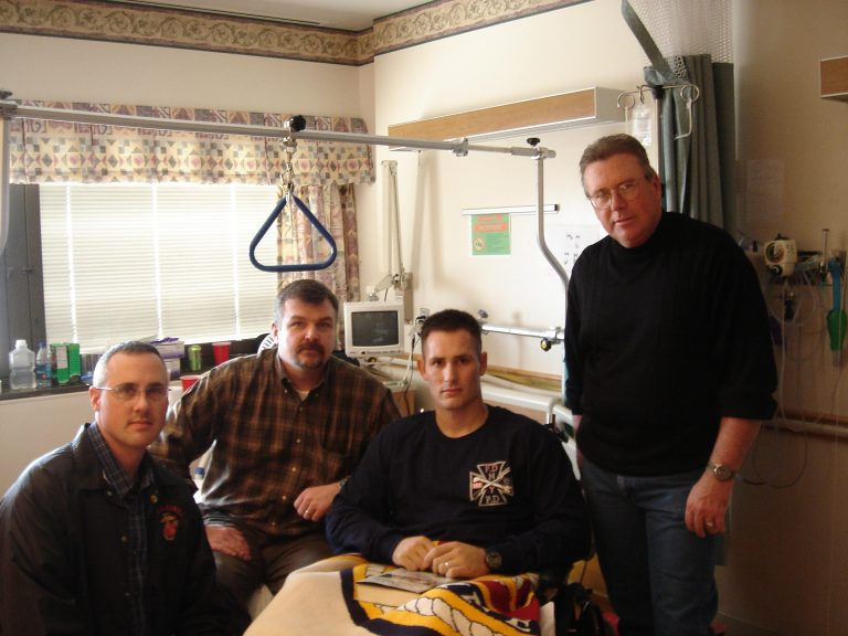 March of 2007: Visiting wounded Marine Scout-Snipers at the Naval Regional Medical Center, Bethesda, Maryland. Gave out free books, personally inscribed. Accompanied by US Marine Corps Scout-Sniper Association President, Allen Boothby (left-center) and Vice President Robert J. Reidsma, then Senior Instructor, Marine Corps Scout-Sniper Instructor School, Quantico, VA. Wounded Marine Scout-Sniper (right-center) Kenneth Dylan Gray. Gunner Charles Henderson (standing right).