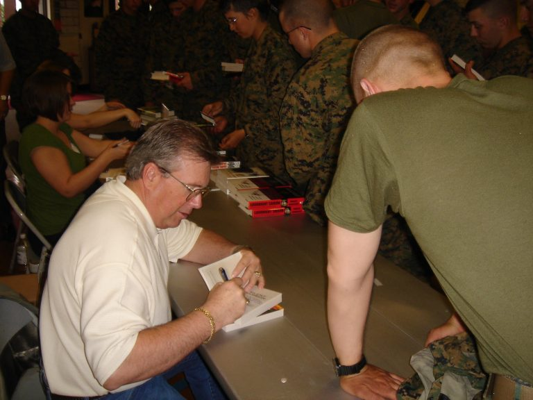 Autographing books for Marines at Camp Lejeune, NC, 2007